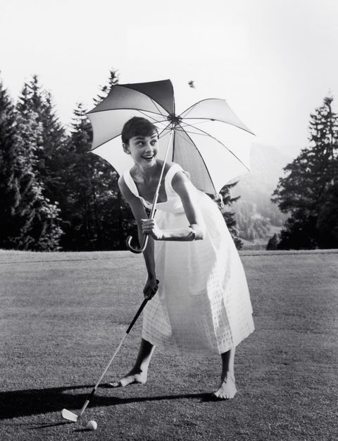 pmc49y audrey hepburn playing golf and holding a parasol, circa 1955 file reference  33536275tha