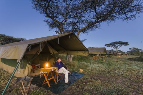 Man and tented camp