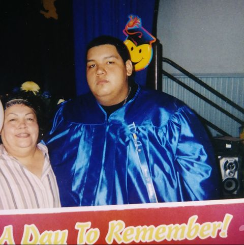 overweight man in graduation gown
