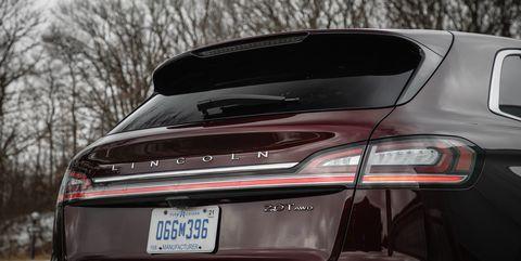 Land vehicle, Vehicle, Car, Luxury vehicle, Automotive design, Automotive exterior, Personal luxury car, Bumper, Crossover suv, Trunk,