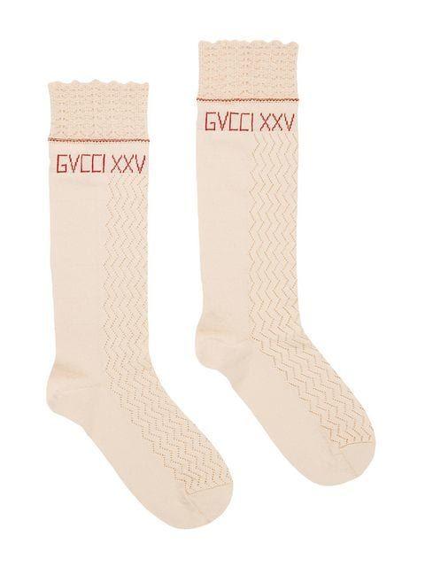 Footwear, Beige, Sock, Boot, Shoe, Fashion accessory,