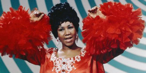 aretha franklin performs on the andy williams show with beehive hair and in a red dress with feathered sleeves and matching earrings