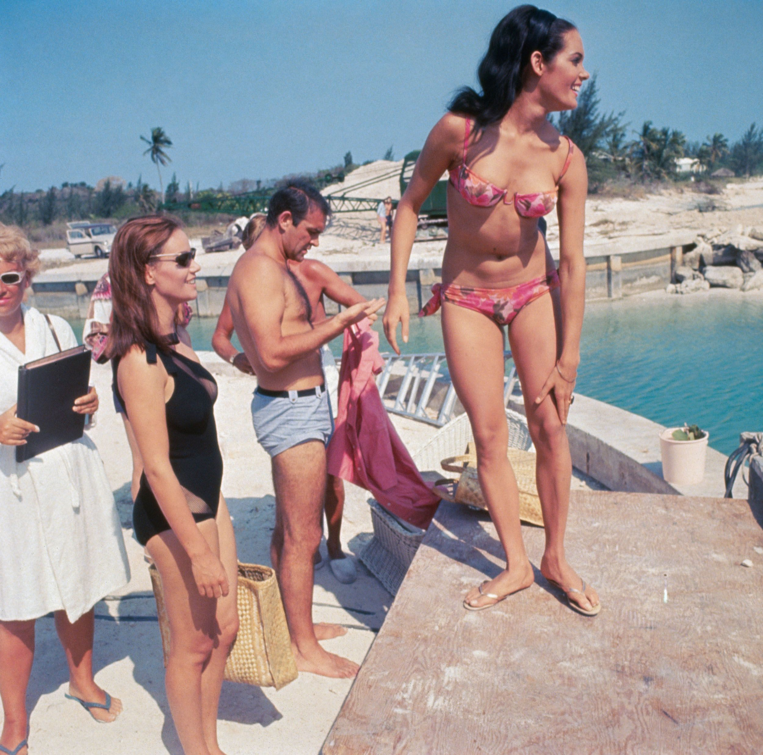 Martine Beswick (pink bikini), Sean Connery (blue trunks) and Claudine Auger (black suit) on set of Thunderball.