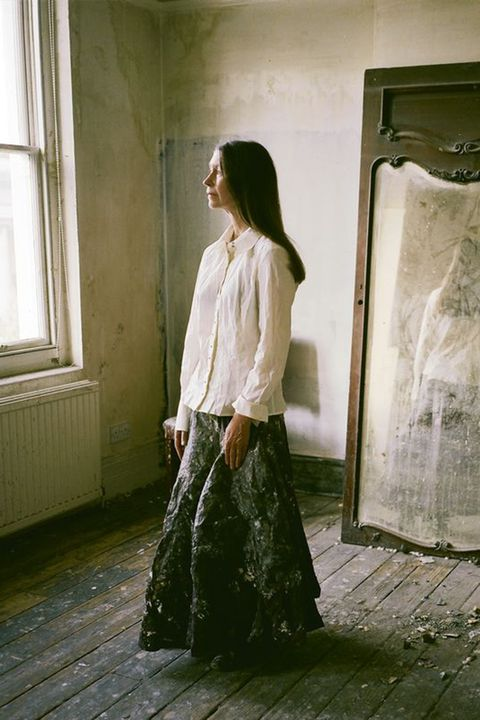 Standing, Fashion, Dress, Outerwear, Photography, Room, Floor, Fashion design, Window, Long hair,
