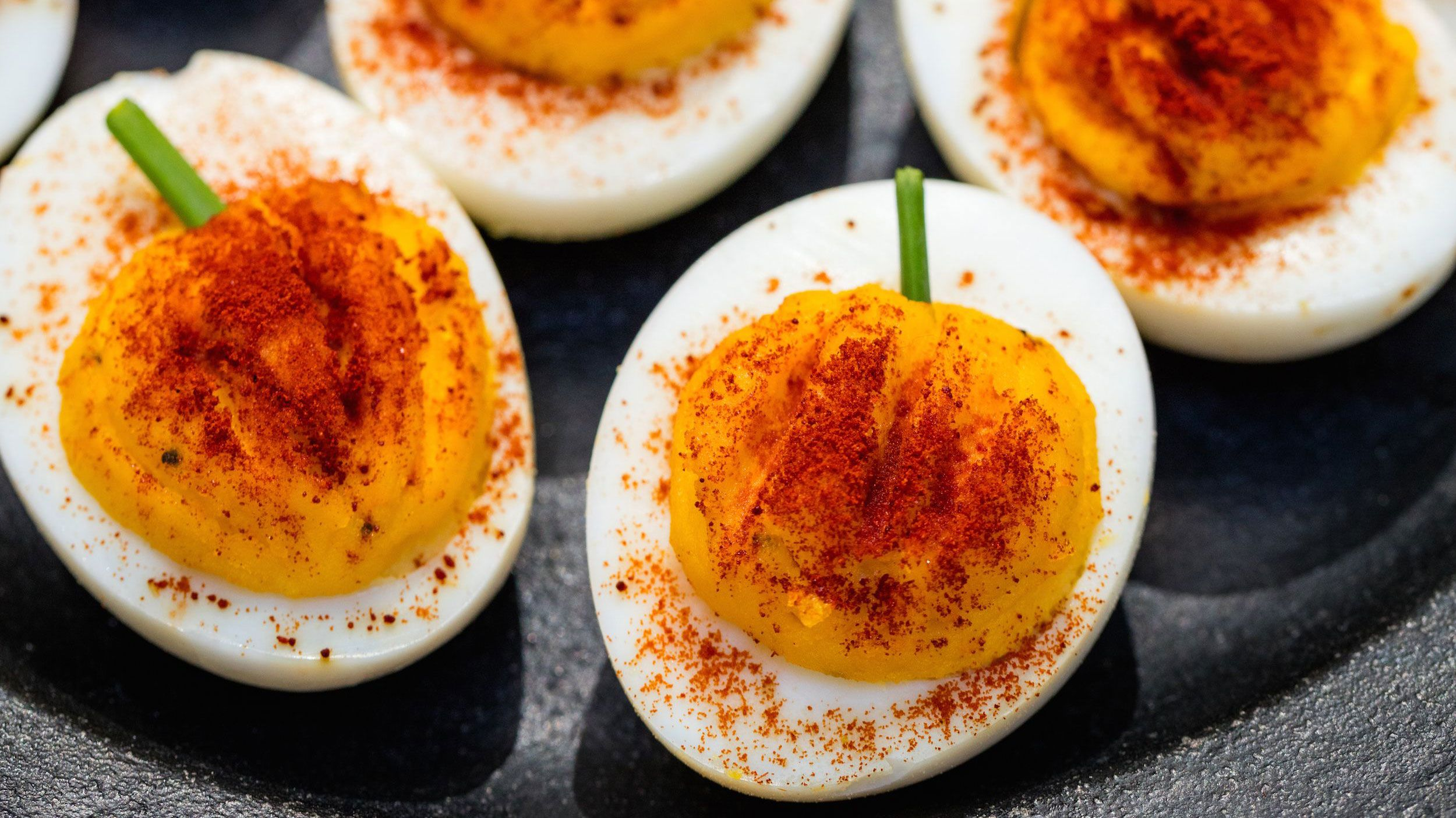 Best Pumpkin Deviled Eggs How To Make Pumpkin Deviled Eggs Delish Com