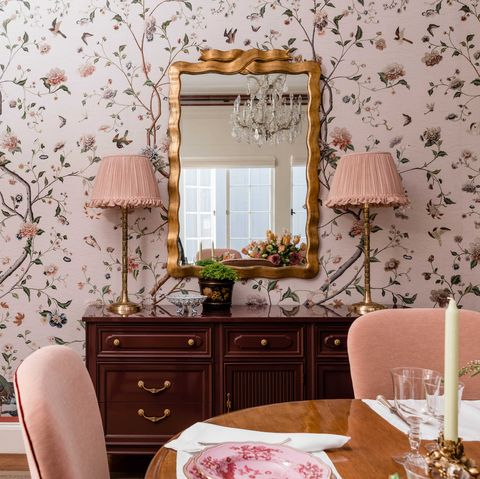 wooden side cabinet, pink lampshade, table lamps, pink floral wallpaper