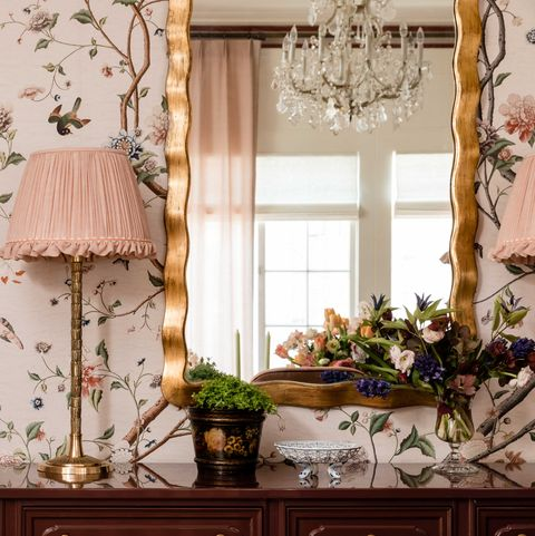 pink floral wallpaper, table lamp with a pink lamp shade