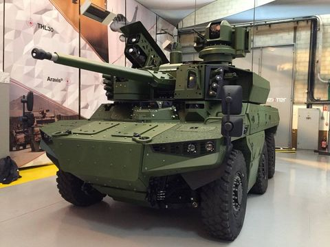Combat vehicle, Tank, Motor vehicle, Vehicle, Armored car, Military vehicle, Self-propelled artillery, Mode of transport, Gun turret, Armored car,