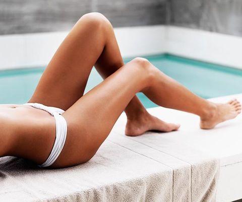 Human leg, Leg, Thigh, Skin, Beauty, Sun tanning, Bikini, Undergarment, Human body, Muscle,
