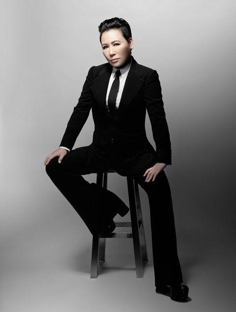 Suit, Formal wear, Clothing, Sitting, Tuxedo, Standing, Fashion model, Fashion, Model, White-collar worker,
