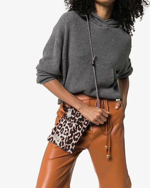 Clothing, Shoulder, Brown, Waist, Fashion, Fashion model, Outerwear, Footwear, Jeans, Photo shoot,