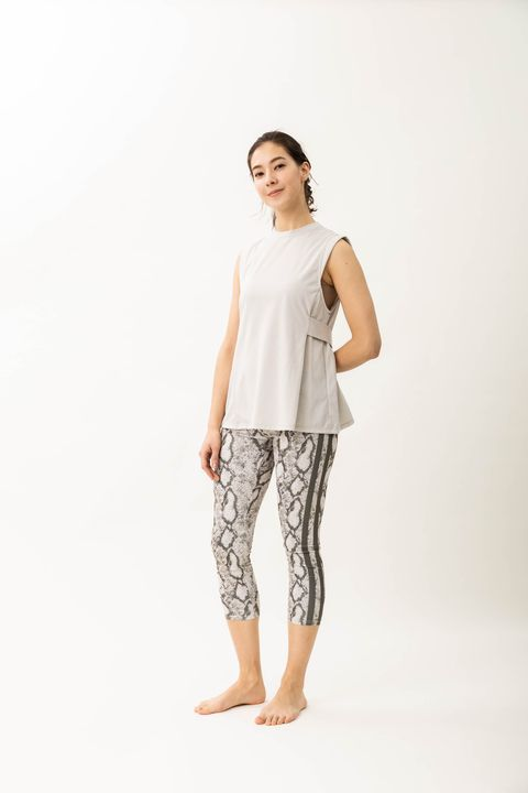 White, Clothing, Leggings, Shoulder, Sportswear, Standing, Pajamas, Nightwear, Trousers, Joint,