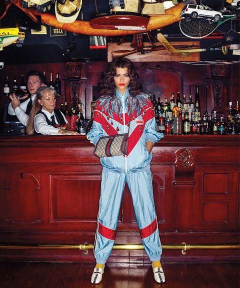 Cabinetry, Pub, Wood flooring, Costume, Distilled beverage, Wood stain, Varnish, Bottle, Tavern, Fictional character,