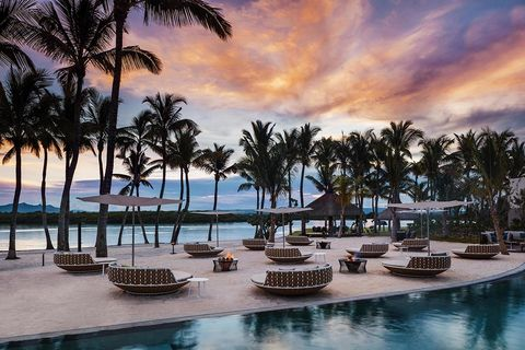 Resort, Swimming pool, Sky, Vacation, Tree, Palm tree, Tropics, Arecales, Leisure, Real estate,