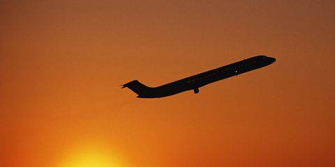 Airplane Taking Off in Sunset Travel