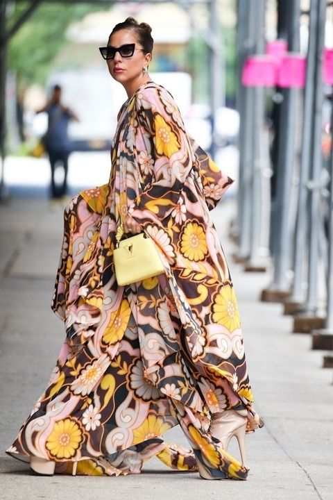 lady gaga in brown and pink floral dress with yellow prada bag