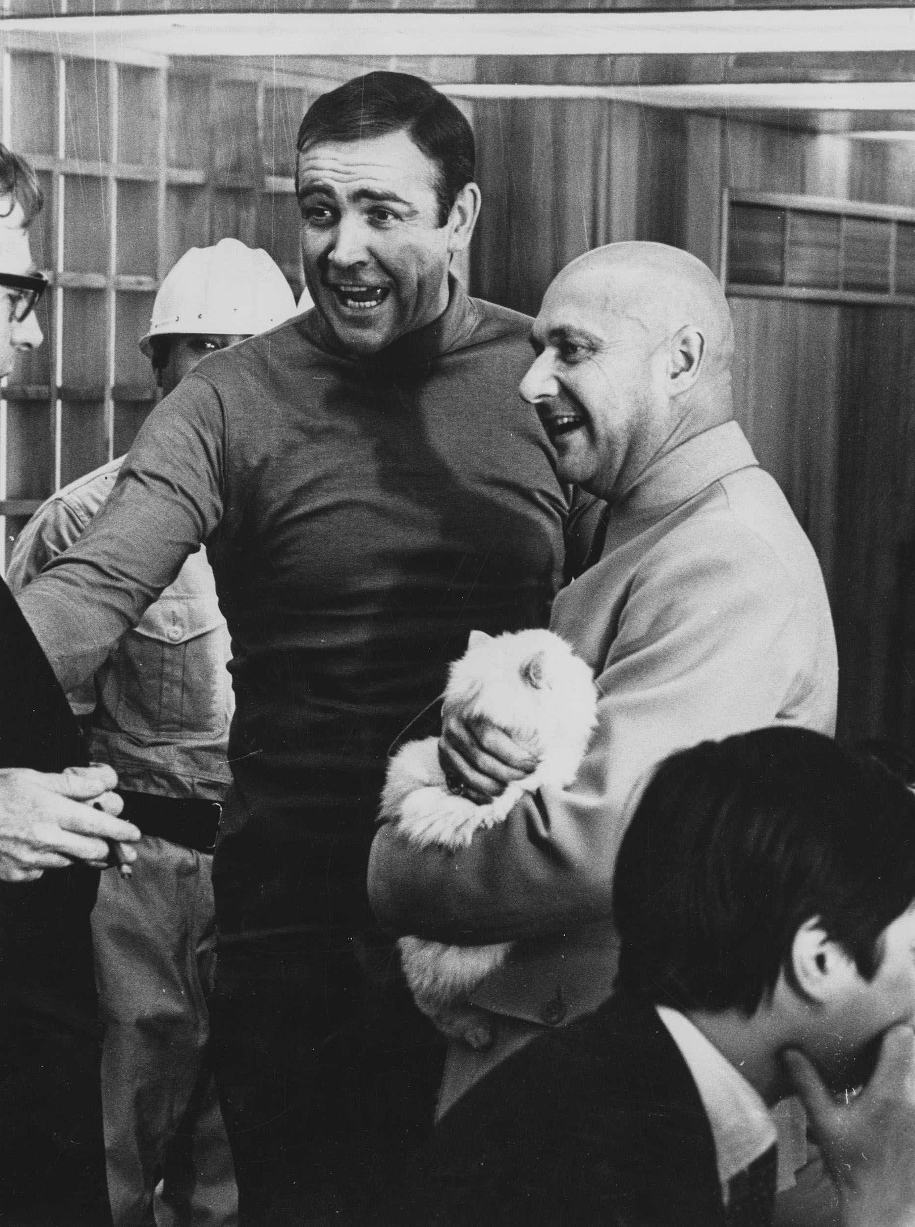 Sean Connery and Donald Pleasance (in costume as Blofeld holding a cat) chatting in between scenes on the set of You Only Live Twice.