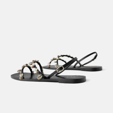 Sandal, Beige, Natural material, Bicycle wheel rim, Slipper, Eye glass accessory, Synthetic rubber, Flip-flops, Slide sandal,