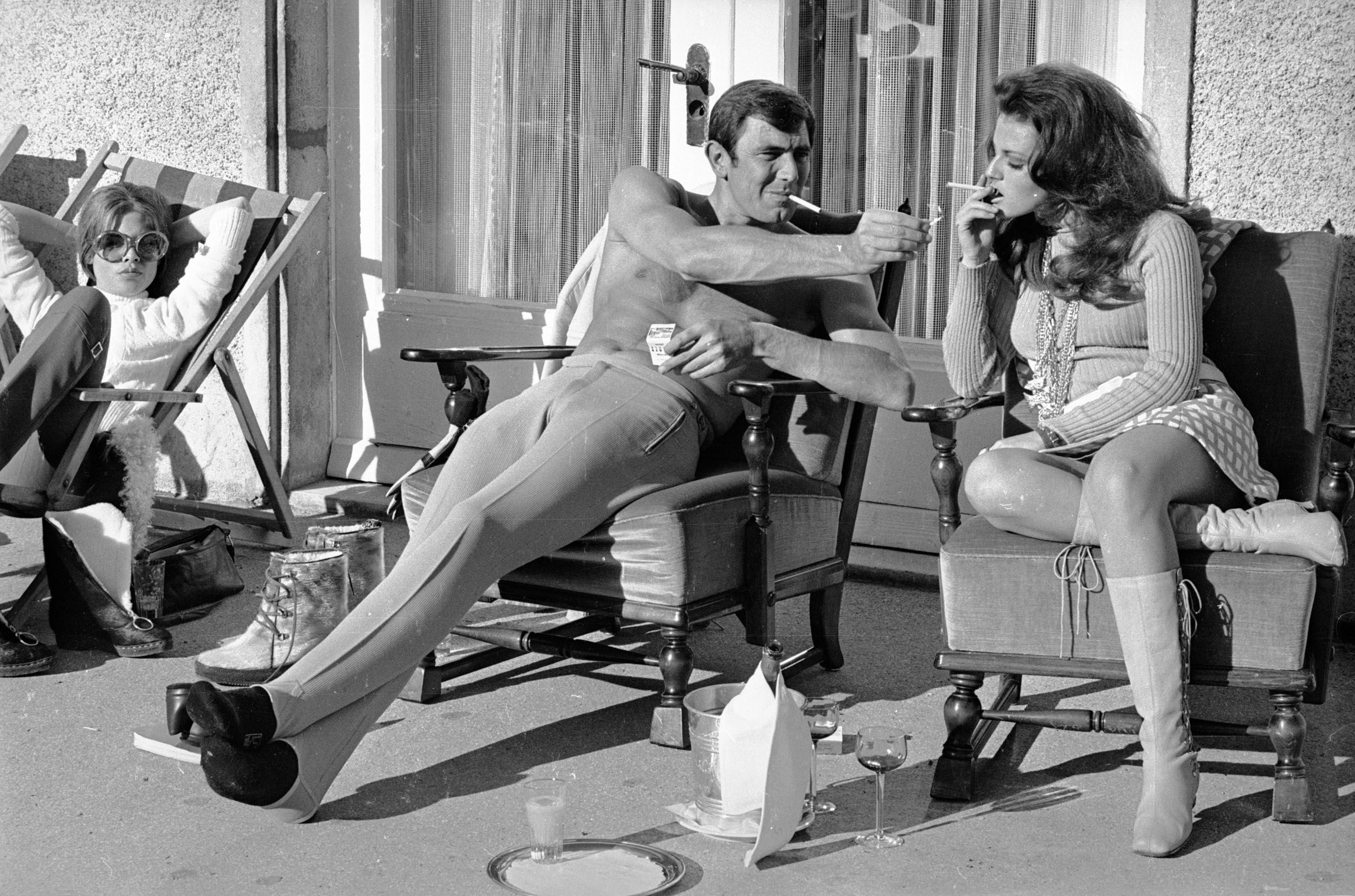 George Lazenby offers co-star Helena Ronee a light, while filming On Her Majesty's Secret Service.