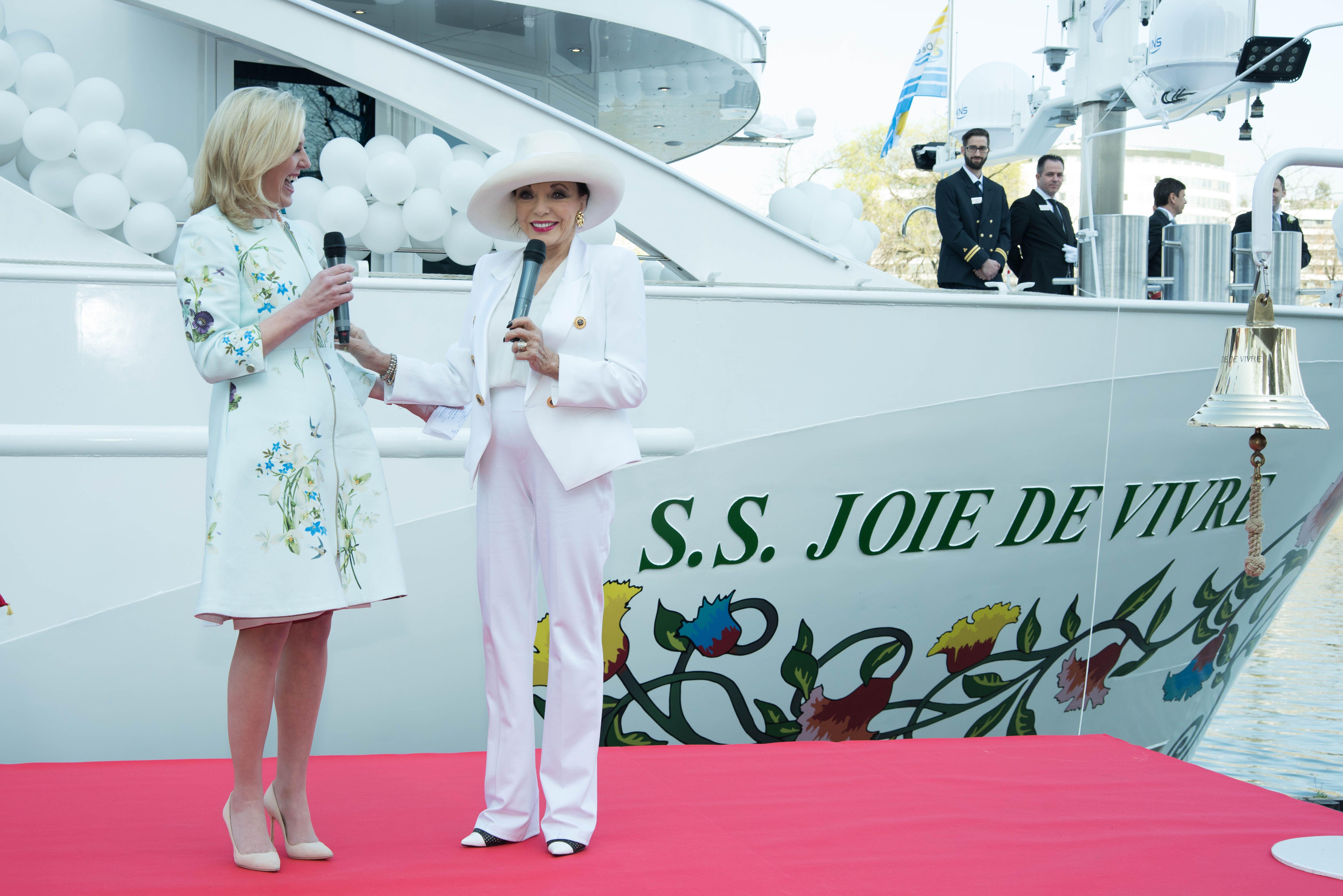 Dame Joan Collins Christening the Joie De Vivre