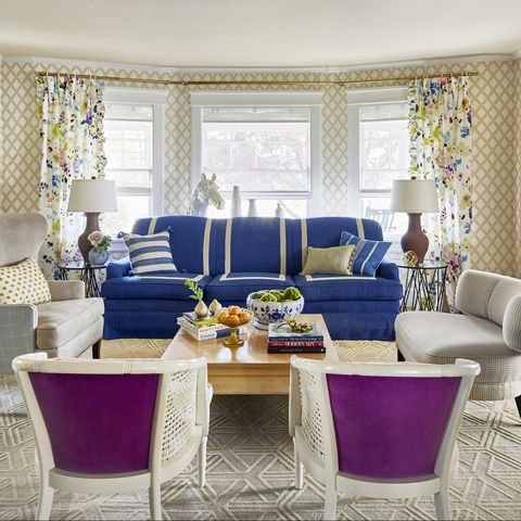 Living room, Room, Blue, Interior design, Furniture, Property, Purple, Coffee table, Building, Table,