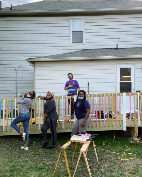 sisters pgh members painting a railing