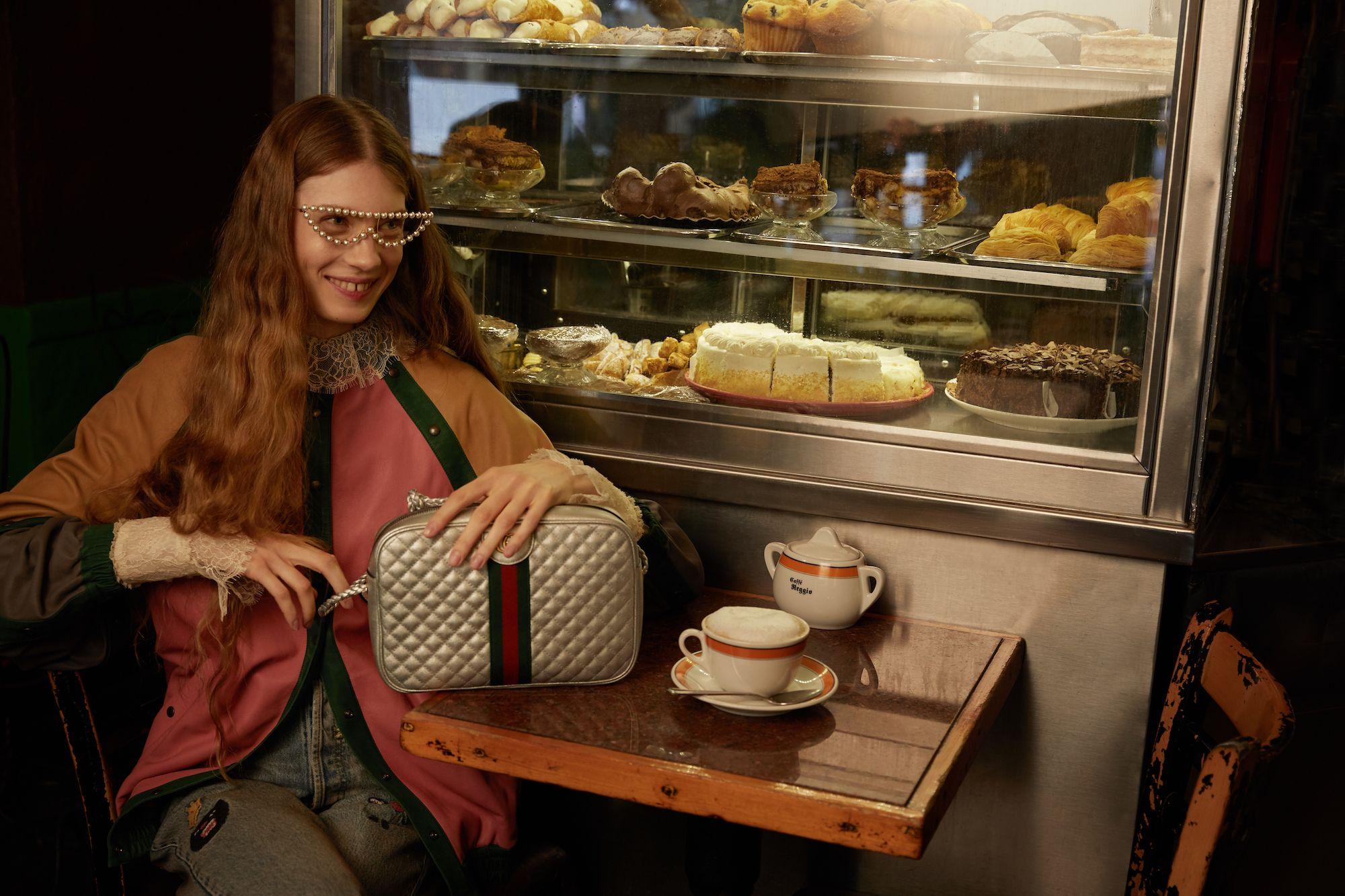 A model holding a Gucci bag