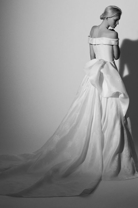 Sleeve, Shoulder, Dress, Textile, Photograph, White, Bridal clothing, Gown, Formal wear, Style,
