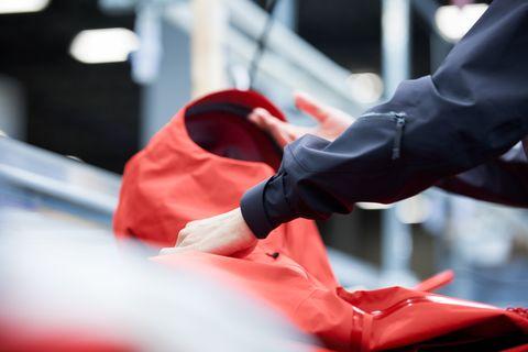Red, Hand, Footwear, Windshield, Carmine, Shoe, Muscle, Automotive window part, Finger, Jacket,