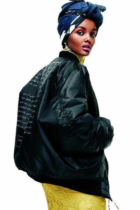 Clothing, Jacket, Outerwear, Yellow, Fashion, Beanie, Sleeve, Leather jacket, Leather, Headgear,