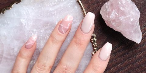 Finger, Skin, Nail, Jewellery, Nail care, Ring, Chemical compound, Natural material, Pre-engagement ring, Silver,