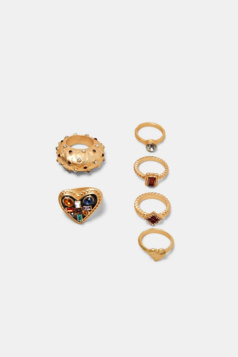 Jewellery, Fashion accessory, Earrings, Body jewelry, Gold, Metal, Gemstone, Circle, Ear, Brass,