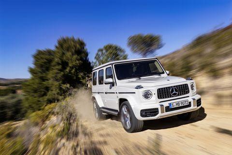 Land vehicle, Vehicle, Car, Mercedes-benz g-class, Automotive tire, Off-roading, Automotive design, Tire, Jeep, Sport utility vehicle,