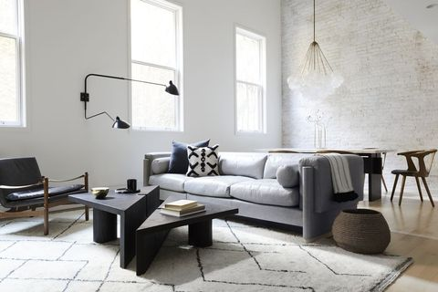 living room, furniture, room, interior design, couch, floor, coffee table, table, property, sofa bed,