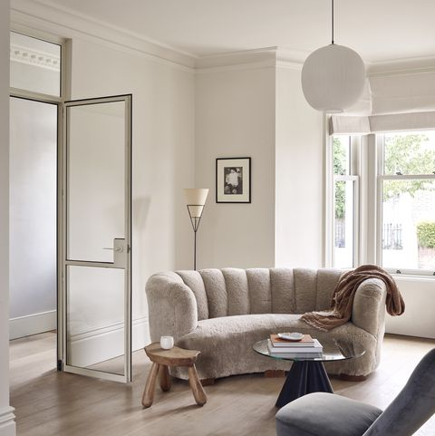 Minimalist London home by Daytrip Studio with vintage furnishings from Beton Brut and artworks from M.A.H.