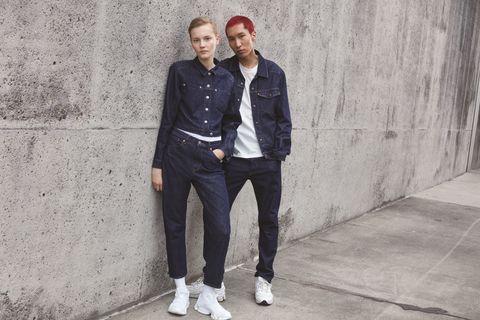 White, Street fashion, Fashion, Jeans, Standing, Jacket, Denim, Wall, Outerwear, Footwear,