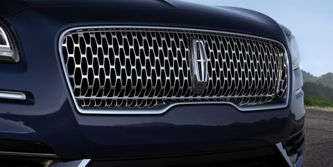 Land vehicle, Vehicle, Car, Grille, Motor vehicle, Automotive design, Luxury vehicle, Automotive exterior, Bumper, Headlamp,