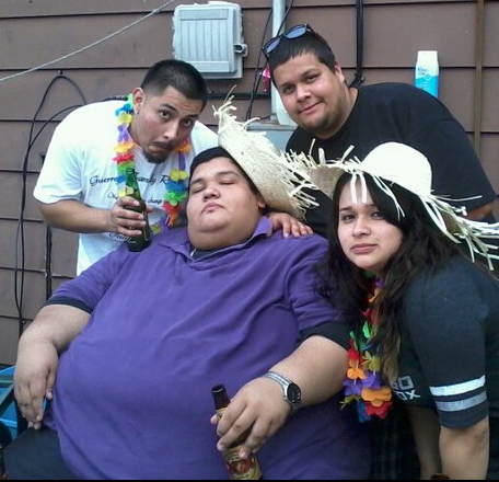 large man with family and friends