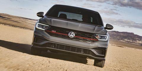 Vehicle, Car, Natural environment, Automotive design, Sand, Landscape, Sky, Aeolian landform, Mid-size car, Desert,