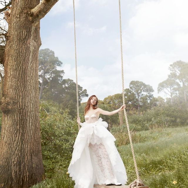 Swing, People in nature, White, Photograph, Dress, Clothing, Wedding dress, Grass, Beauty, Gown,