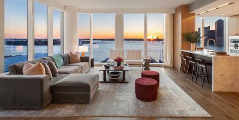 Living room, Room, Furniture, Property, Interior design, Building, Floor, Wood flooring, House, Coffee table,