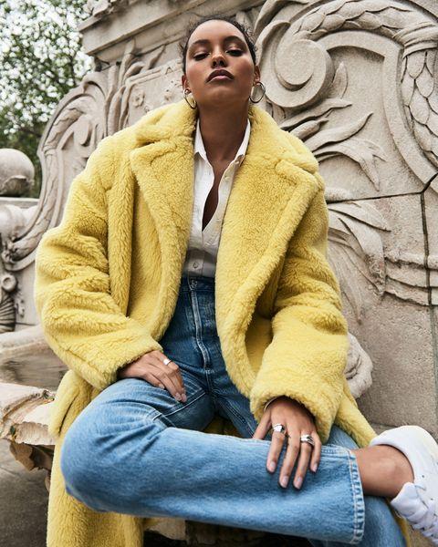 A model in a yellow fur coat