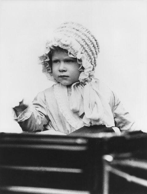 Photograph, Black-and-white, Sitting, Headgear, Vintage clothing, Photography, Child, Stock photography, Monochrome, Portrait,
