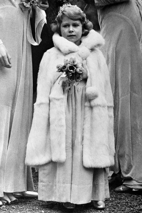 Photograph, Standing, Fur, Black-and-white, Snapshot, Outerwear, Fur clothing, Vintage clothing, Stock photography, Monochrome,