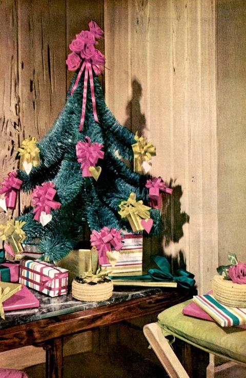 Pink, Christmas tree, Tree, Christmas decoration, Room, Plant, Interior design, Table, Wood, Furniture,