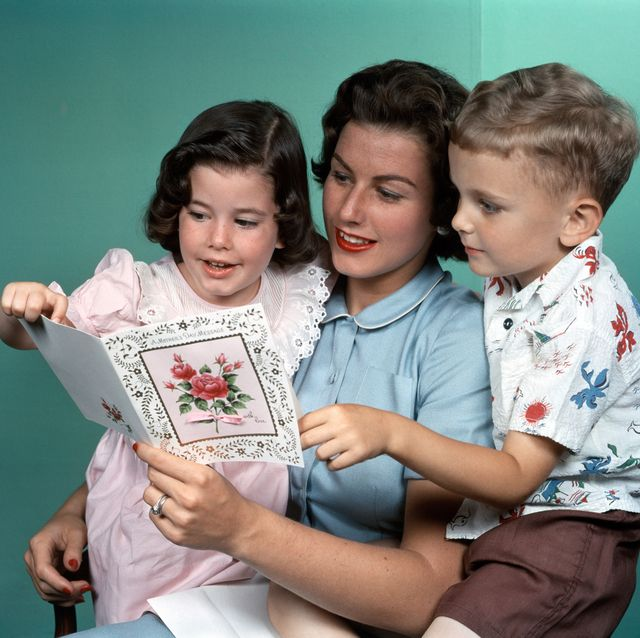 1950s MOTHER LOOKING AT...