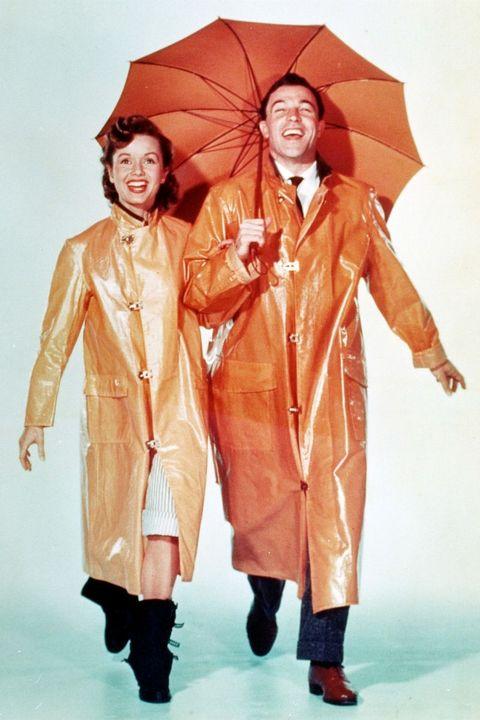 sleeve, human body, umbrella, standing, collar, formal wear, costume design, orange, fashion, peach,