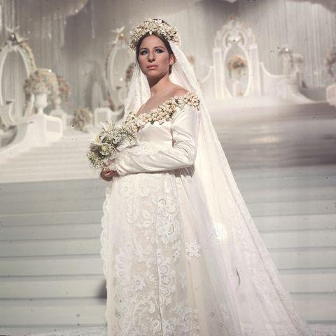 Wedding dress, Clothing, Gown, Dress, White, Bride, Bridal clothing, Shoulder, Fashion model, Bridal accessory,