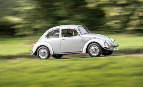 Land vehicle, Vehicle, Car, Regularity rally, Motor vehicle, Coupé, Classic car, Volkswagen beetle, Classic, Rim,