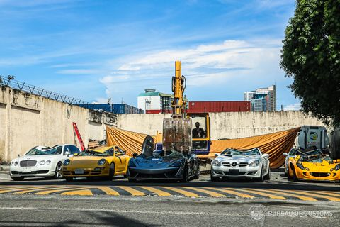 seven cars are crushed by the philippines bureau of customs